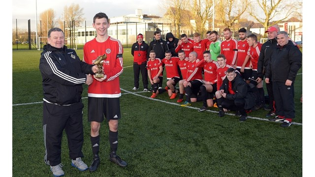 "Enda Love of the Irish FA Junior committee presents the ""Man of the Match"" trophy to Willowbanks Richard McAvoy.jpg"
