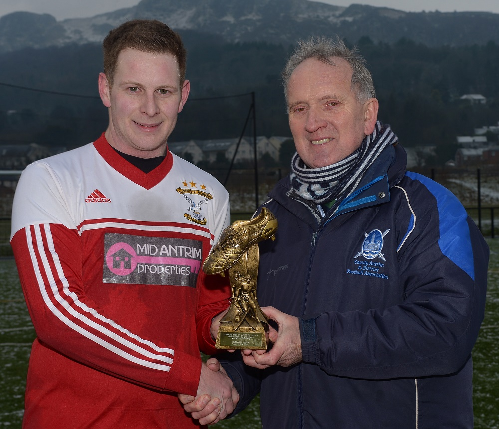 Paul McNeill receives his man of the match award from Robert Donaghy, IFA Junior Committee.jpg