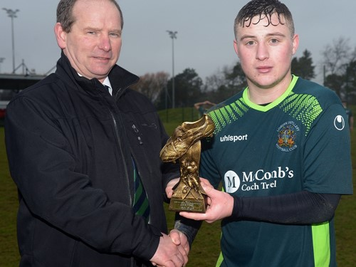 Lisburn Distillery's Jonathan McCaw receives the 'Man of the Match' trophy from Colin McCullough (vice Chairman) of the Irish FA Intermediate Cup Committee.jpg