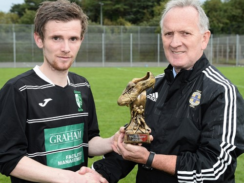 Thomas Murray of Tullymore Swifts with IFA Junior Committee member Robert Doherty.jpg