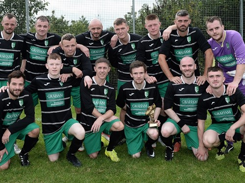 Tullymore Swifts with man of the match Thomas Murray.jpg