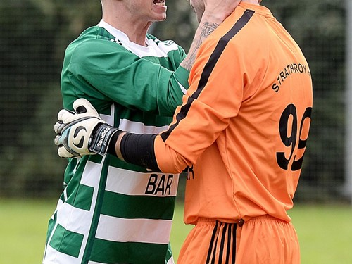 Strathroy keeper Thomasz Antczac celebrates with team mate Mark Gilloway after he saves the decisive penalty.jpg