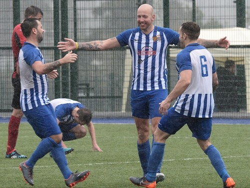 Andy Reay celebrates with his teammates.jpg