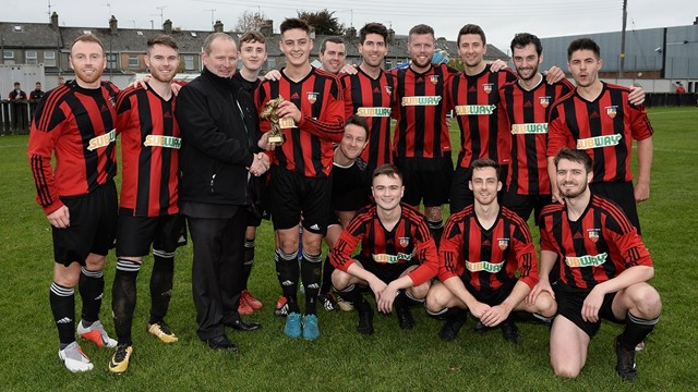 Man of the Match Stephen McCavitt with his teammates and Intermediate Cup chairman Colin McCullough.jpg