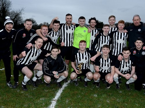 Man of the match Ciaran Reid celebrates with his team mates.jpg