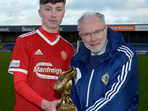 Man of the Match Oisin Conaty recieves his trophy from Brian Larkin of the IFA Youth Committee.jpg