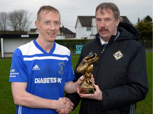 Dollingstowns Glenn Hand recieves his %22Man of the Match%22 trophy from Irish FA Intermediate Committee Member Alistair Gray.jpg