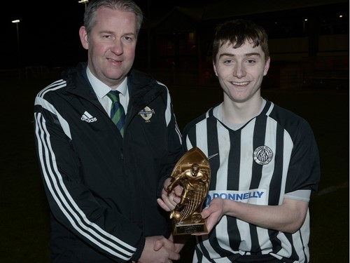Chairman of the Irish FA Junior and Youth Committee Maurice Johnston presenting the Man of the Match trophy to Calvin McCurry.jpg