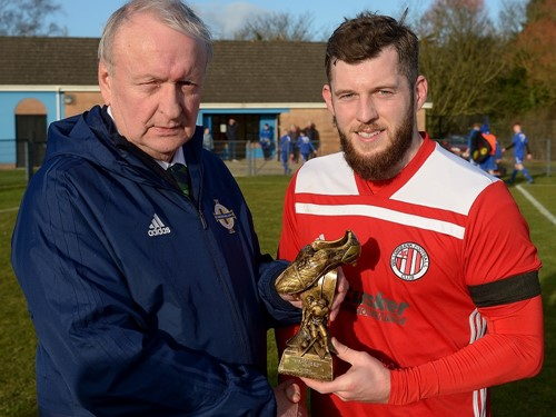 Desi Bradley of the Irish FA Junior Committe presents Pearse Devine of Willowbank with his Man of the Match Trophy.jpg