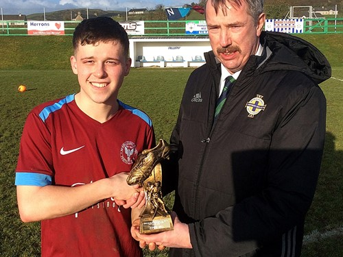 Alistair Gray of the Irish FA Intermediate Cup Committee presents Man of the Match Dylan McCorkell of Newbuildings United with his trophy.jpg