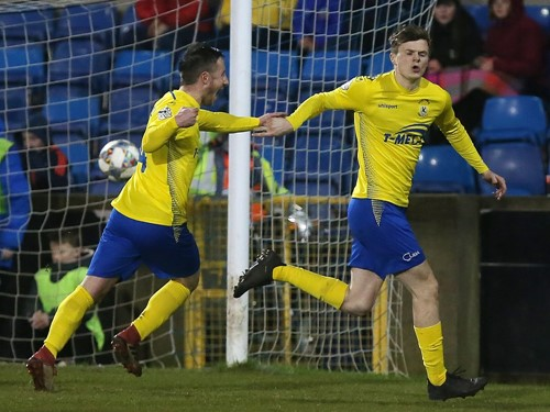 Paul McElroy (right) celebrates scoring Dungannon's winner.jpg