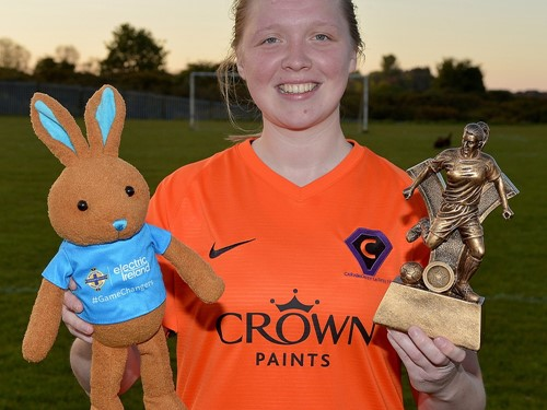Hollie Johnston with her 'player of the match' trophy and Electric Ireland bunny.jpg
