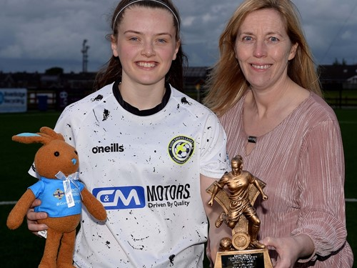 Tyler Toland of Sion Swifts Ladies recieves her Player of the Match trophy and Electric Ireland Bunny from Elaine J.jpg