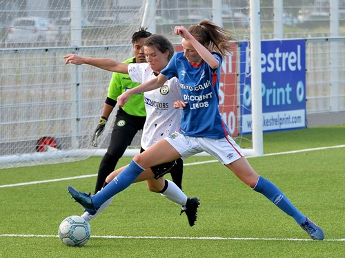 Player of Match Caitlin McGuinness in action 2.jpg