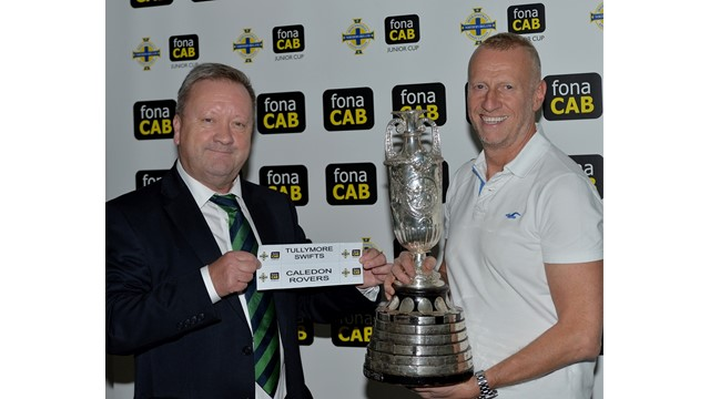 1- Jim Jess (Chairman of the Irish FA Junior committee shows the __Tie of the 1st round__of the fonaCAB Junior Cup which is being held by William McCausland (CEO of fonaCAB) .jpg