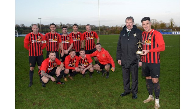 Alistair Gray, Irish FA Intermediate Committee, presents Daniel Purkis with his man of the match award.jpg