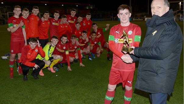 "Robert Doherty of the Irish FA Youth Committee presents Cliftonville Strollers Peter McKiernan with his ""Man of the Match"" trophy as his team mates look on.jpg"