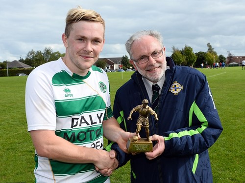 Armagh Celtic's Josh McCarten receives his Man of the Match award from Brian Larkin of the Irish FA Junior Committee.jpg