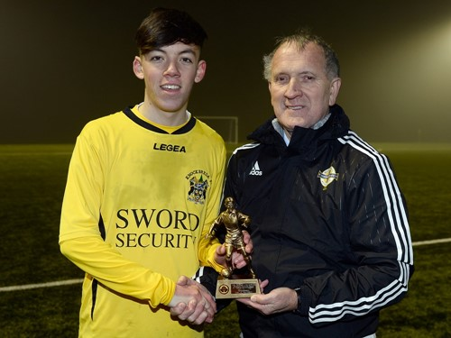 MOM Ryan Tweedy of Knockbreda with Robert Doherty of the Irish FA Junior and Youth Committee (002).jpg
