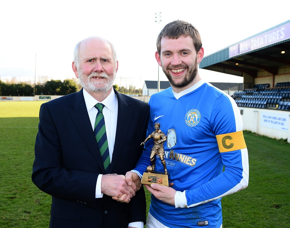 Gerry Stewart of the Irish FA Intermediate Cup Committee presents Limavady Utd's Captain Hugh Carlin with the Man of the Match Trophy  (002).jpg